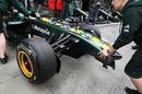 Karun Chandhok's damaged Lotus returns to the pits