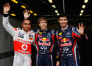Sebastian Vettel poses with Lewis Hamilton and Mark Webber after securing pole