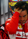 Fernando Alonso takes some time out in the Ferrari garage