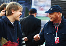 Sebastian Vettel shares a joke with Niki Lauda