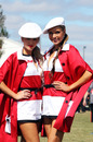 The grid girls prepare to line up