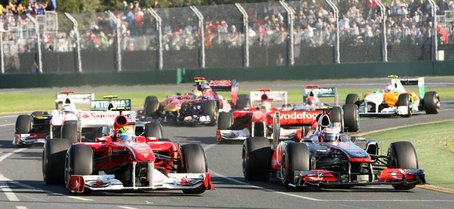 Felipe Massa  and Jenson Button battle at the start of the race