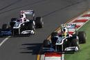 Rubens Barrichello battles team-mate Pastor Maldonado