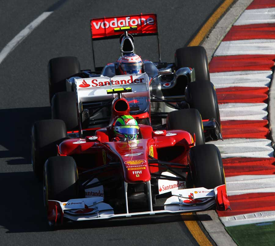 Jenson Button struggles to get past Felipe Massa