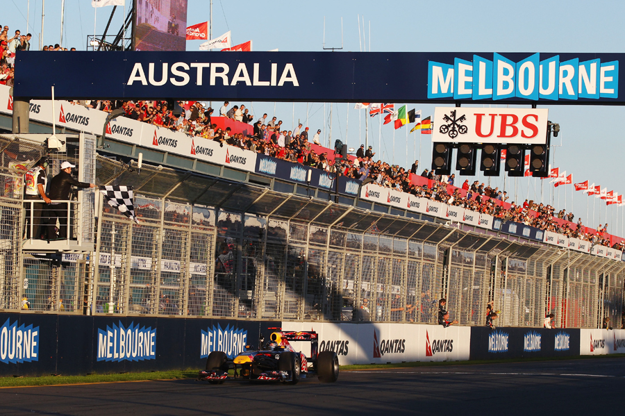 Sebastian Vettel takes the chequered flag to win