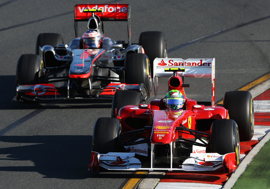 Felipe Massa holds off a strong challenge from Jenson Button