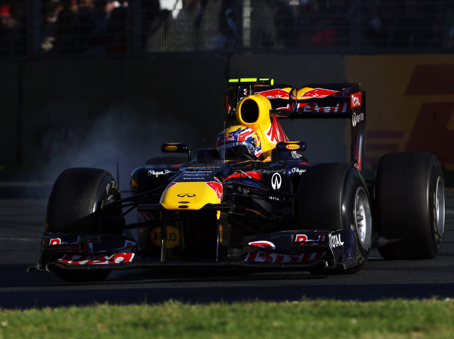Mark Webber locks a tyre during his first stint