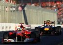 Mark Webber uses the DRS in pursuit of Fernando Alonso