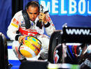 Lewis Hamilton takes a closer look at the race-winning Red Bull