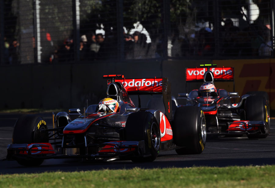 The McLarens of Jenson Button and Lewis Hamilton run nose-to-tail through turn three
