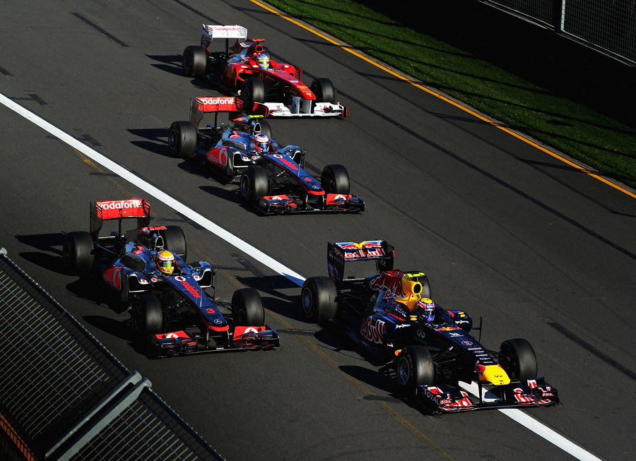 Mark Webber edges ahead of Lewis Hamilton at the start of the race