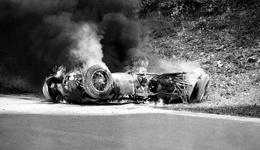 Willy Mairesse's burning Ferrari after his collision with Trevor Taylor's Lotus
