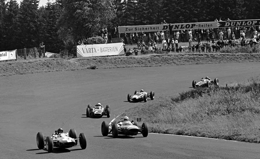 John Surtees (right) puts pressure on race leader Jim Clark