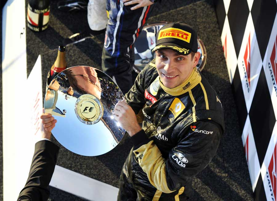 Vitaly Petrov celebrates his third position at Albert Park
