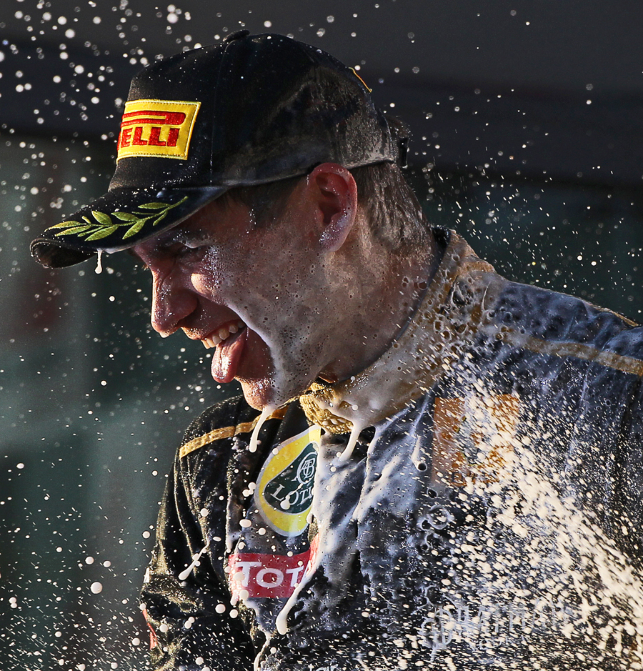 Vitaly Petrov gets a face full of champagne on the Albert Park podium