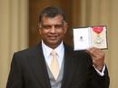 Lotus boss Tony Fernandes holds his CBE medal awarded to him by Princess Anne at an investiture ceremony at Buckingham Palace