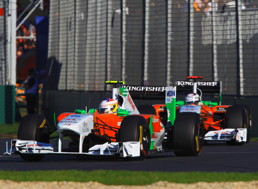 Paul di Resta and Adrian Sutil run nose to tail