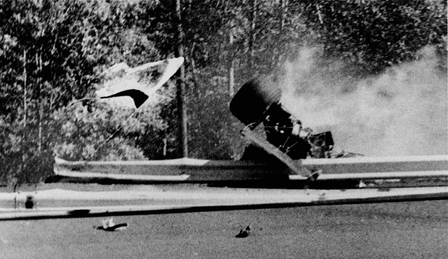 Francois Cevert's Tyrrell sits on the guardrail after his fatal crash