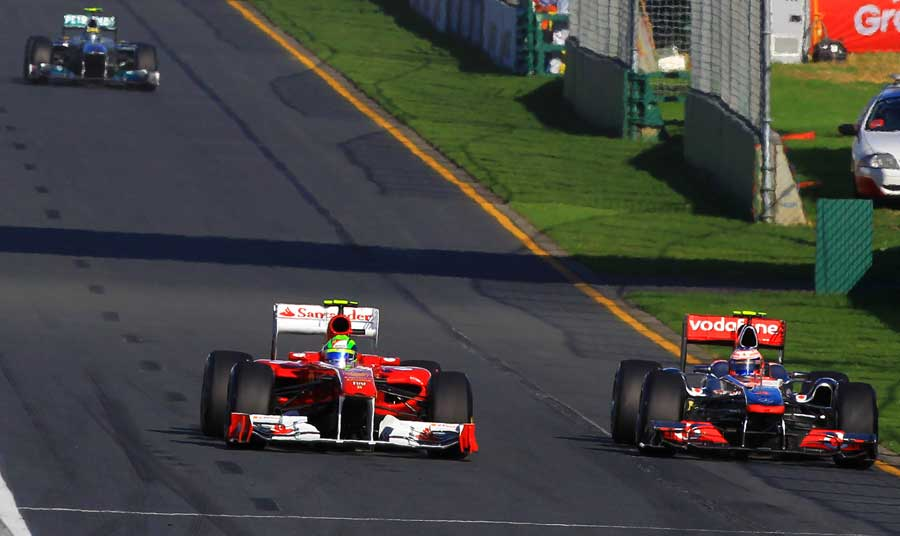 Jenson Button tries to go round the outside of Felipe Massa