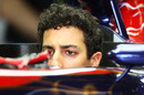 Daniel Ricciardo makes himself comfortable in the Toro Rosso cockpit