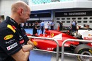 Adrian Newey inspects the Ferrari 150th Italia in parc ferme