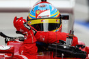 Fernando Alonso gets out of his Ferrari after qualifying fifth
