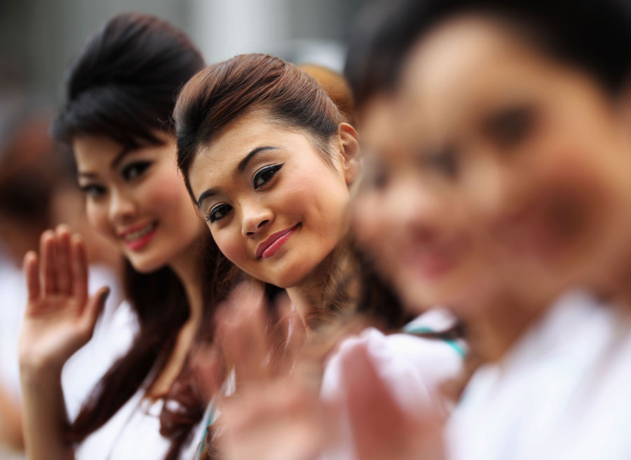 Petronas grid girls smile for the camera