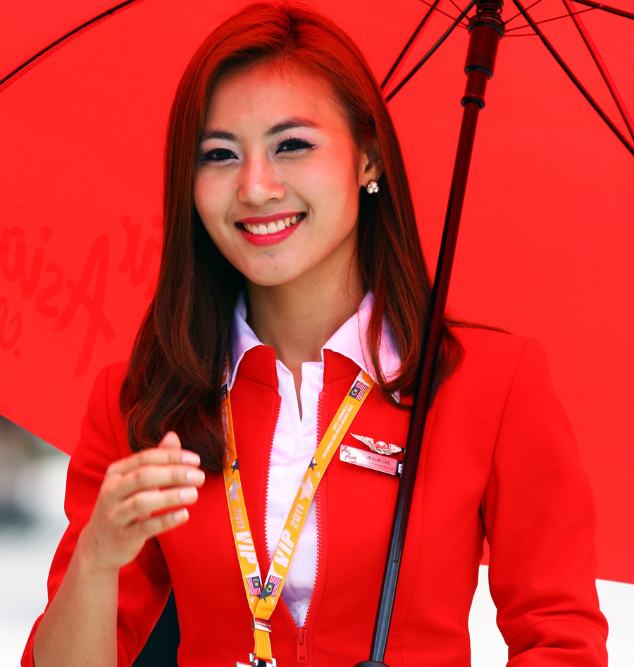 An Air Asia stewardess outside the Lotus garage