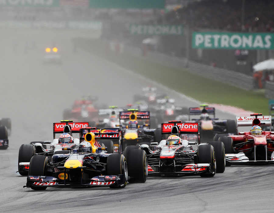 Sebastian Vettel leads the way in to the first corner