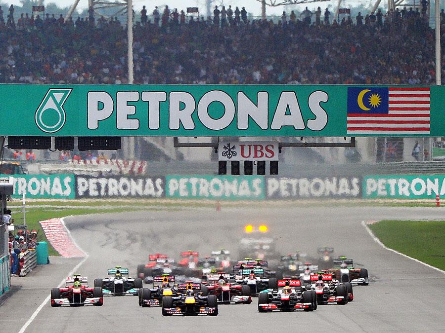 Sebastian Vettel makes a good start as the cars rocket from the grid