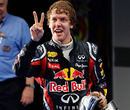 Sebastian Vettel celebrates for the cameras