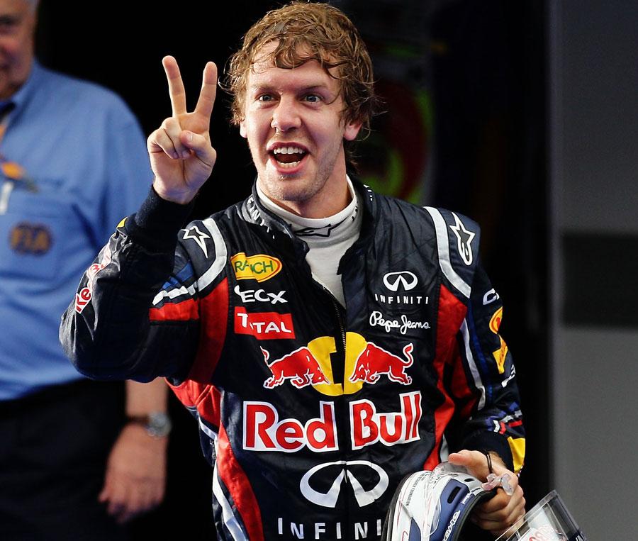 Sebastian Vettel celebrates for the cameras
