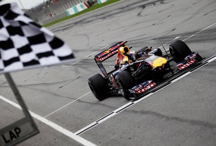 Sebastian Vettel crosses the line to take victory for Red Bull