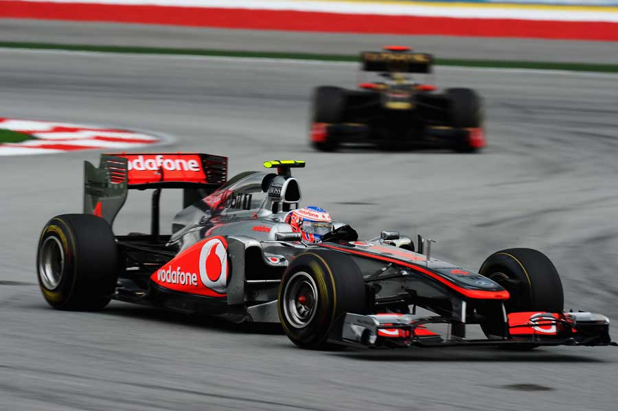 Jenson Button leads Nick Heidfeld through turns one and two