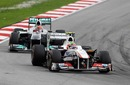 Michael Schumacher battles with Sergio Perez