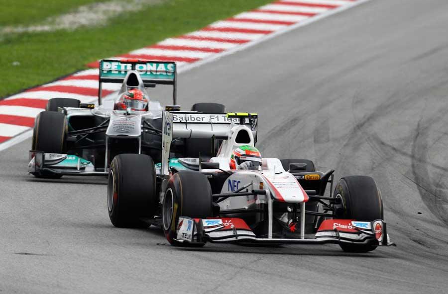 Michael Schumacher battles with Sergio Perez