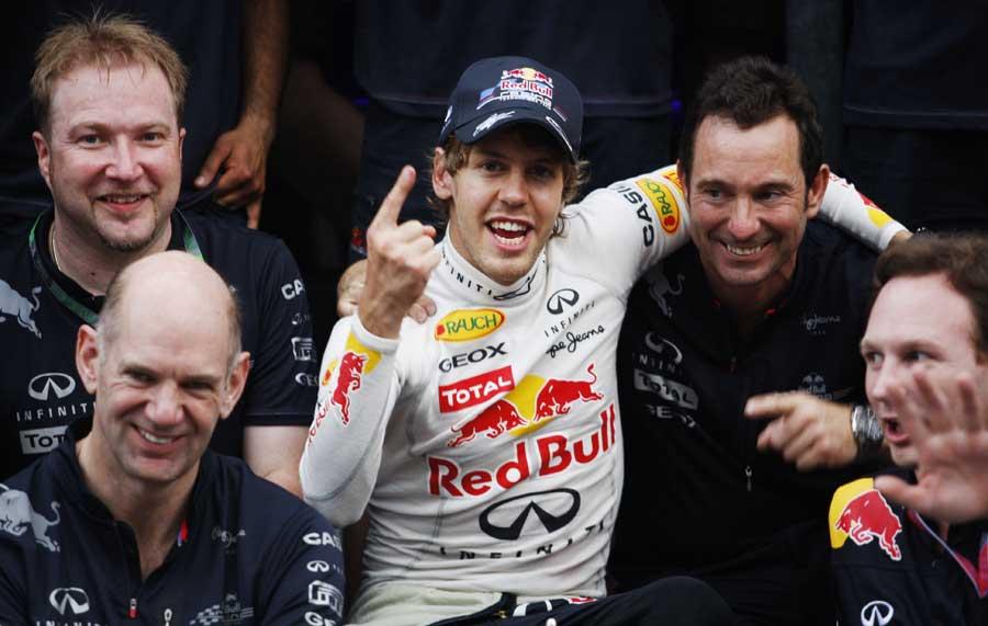 Sebastian Vettel celebrates with the Red Bull team