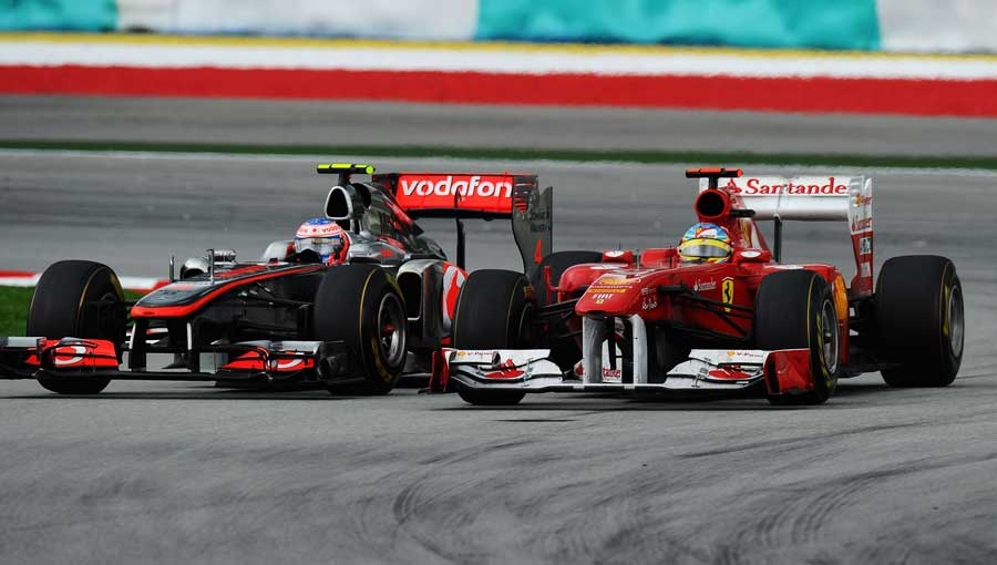 Fernando Alonso battles with Jenson Button