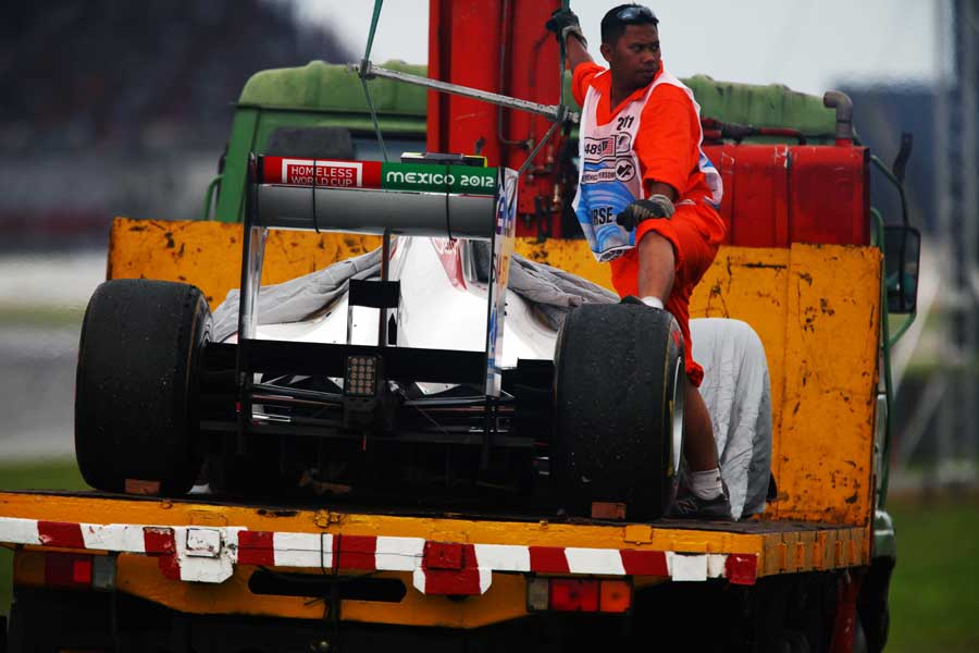 Sergio Perez's car is recovered after he retired