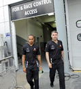 Lewis Hamilton walks back from the FIA stewards' room after being penalised for blocking Fernando Alonso