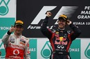 Sebastian Vettel and Jenson Button celebrate on the podium
