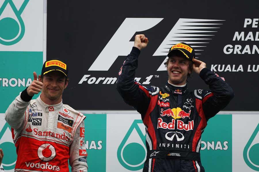 Sebastian Vettel and Jenson Button celebrate on the podium