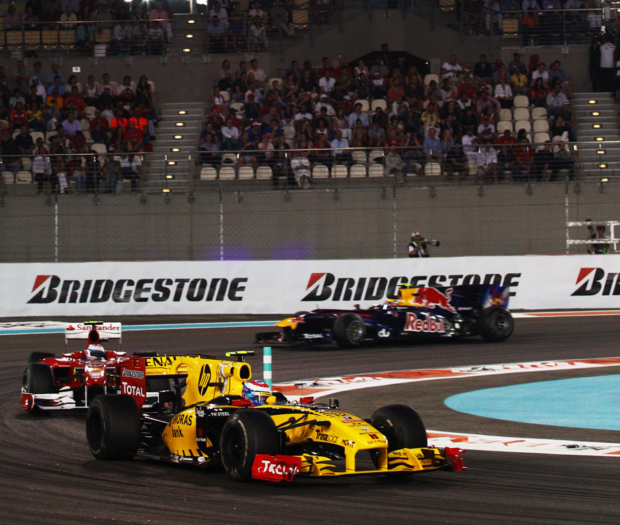 Vitaly Petrov holds off Fernando Alonso and Mark Webber