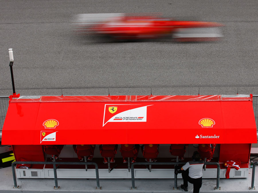 Ferrari monitors progress from the pit wall
