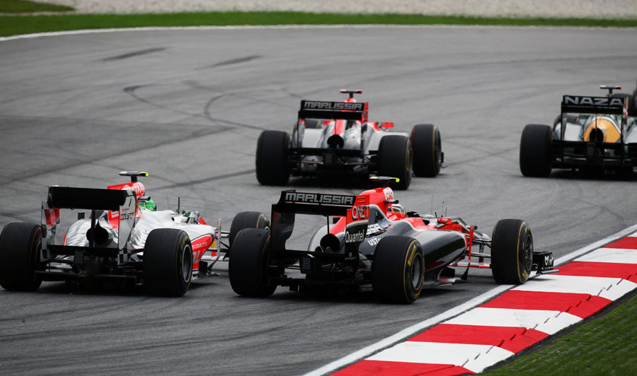 Tonio Liuzzi goes wheel-to-wheel with Jerome d'Ambrosio