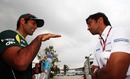 Karun Chandhok and Narain Karthikeyan catch up in the paddock on Friday