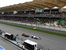 Vitaly Petrov uses his DRS system to close on Kamui Kobayashi, Malaysian Grand Prix, Sepang, April 10, 2011