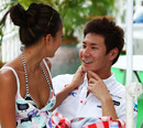 Kamui Kobayashi with his girlfriend Yu Abiru in the paddock