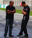 Lewis Hamilton and father Anthony check out his grid spot the night before the race