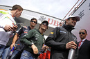 Paul Di Resta, Mark Webber, Jarno Trulli and Tonio Liuzzi head to the drivers parade